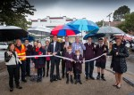 Pictured: The 'brollied' local residents together with St Michael's Grammar Principal Simon Gipson, staff and students plus Cr Andrew Bond watch-on as MP Clem Newton Brown cuts the ribbon.